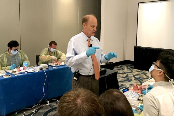 Faculty Director leading dental implant surgical course